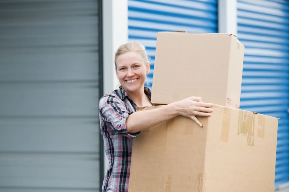 A woman moving boxes out of a storage unit at StayLock Storage in Leesburg, Georgia