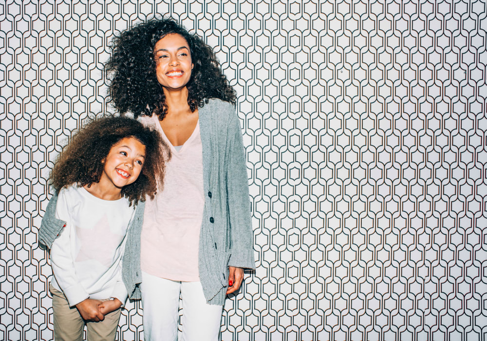 Resident mother and daughter posing for a photo at Sofi Irvine in Irvine, California