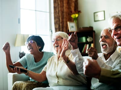 Residents cheering at Randall Residence of Encore Village in Brighton, Michigan