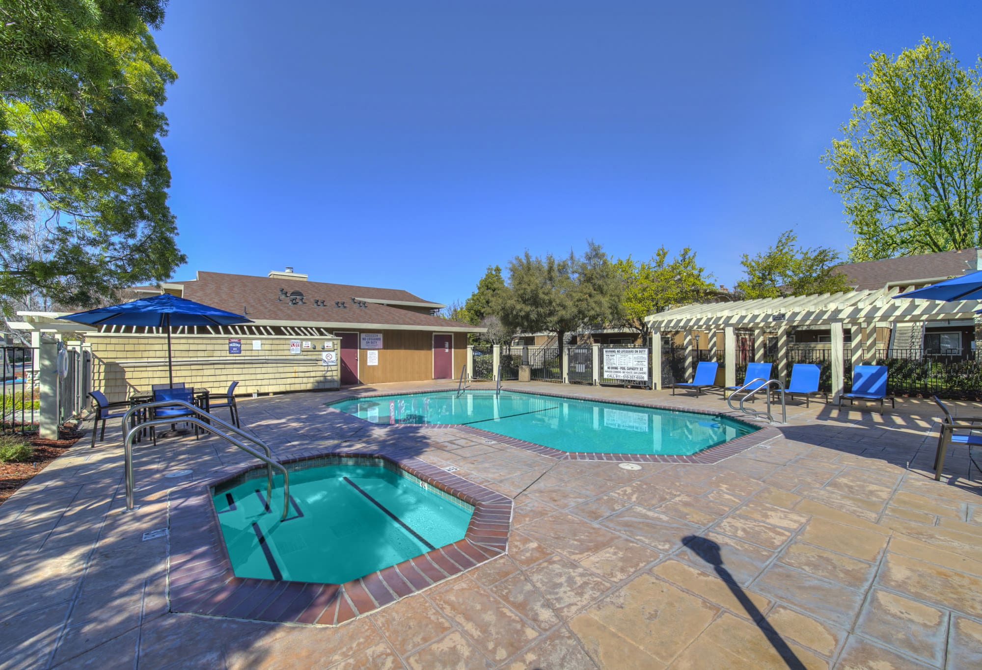 Pool and spa with lounge chairs and poolside BBQ in San Leandro, CA