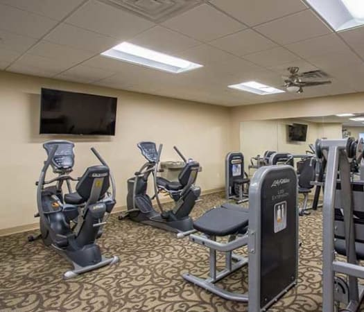 Fully equipped fitness center at The Marquis at the Woods in Webster, New York