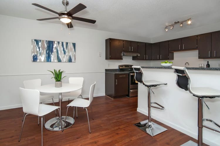 Dining area and kitchen at The Enclave