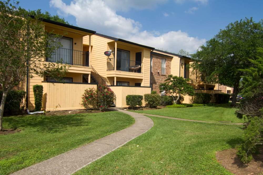 Enjoy the beautiful front view of Meadow Park Apartments in Alvin, Texas