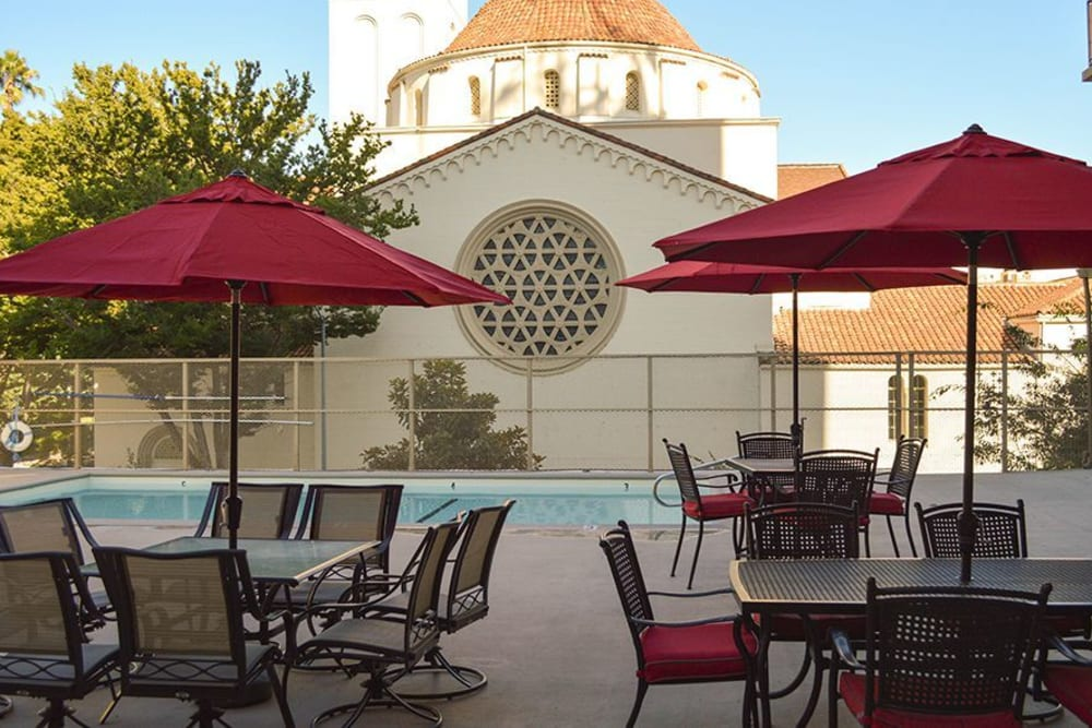 Refreshing pool and outside lounge area at Park Place Senior Living in Sacramento, California