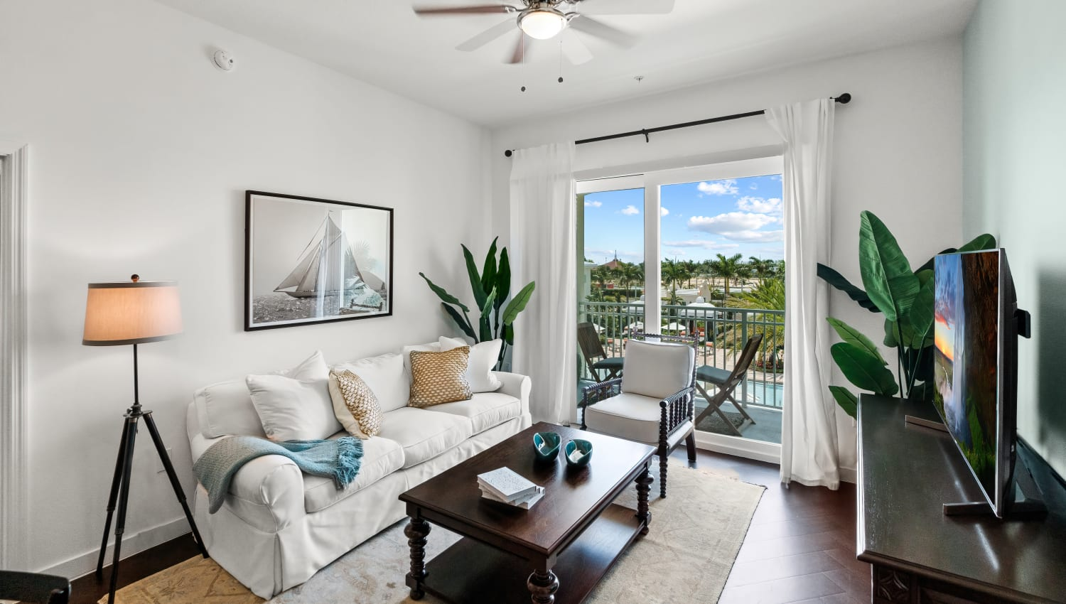 Well decorated living room with great views and a private balcony at Town Lantana in Lantana, Florida