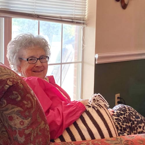 Resident sitting by a window at Canoe Brook Assisted Living in Duncan, Oklahoma