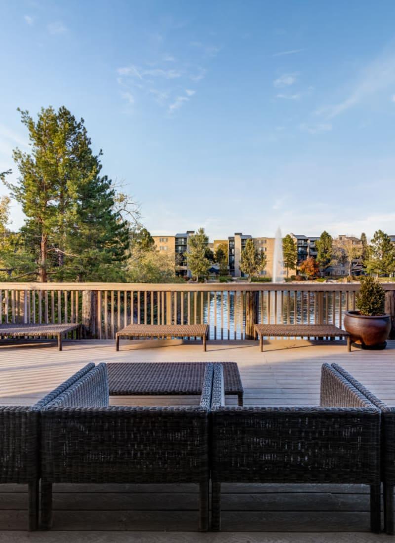 Outdoor sitting area overlooking lake at Ashford Belmar in Lakewood, Colorado