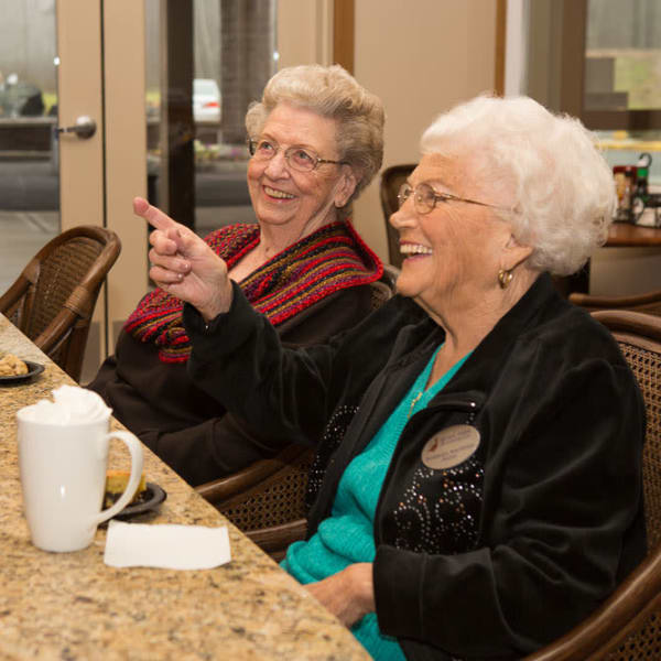 Two residents ordering food at Quail Park of Lynnwood in Lynnwood, Washington