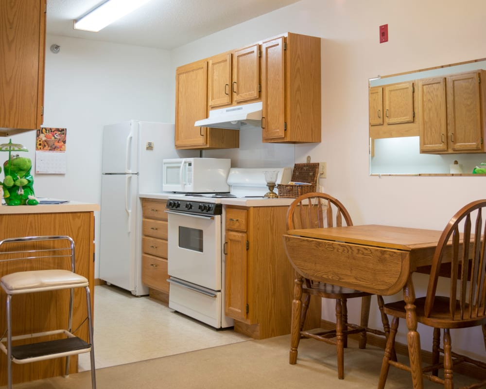 Resident apartment with a galley kitchen at Meadow Lakes Senior Living in Rochester, Minnesota.