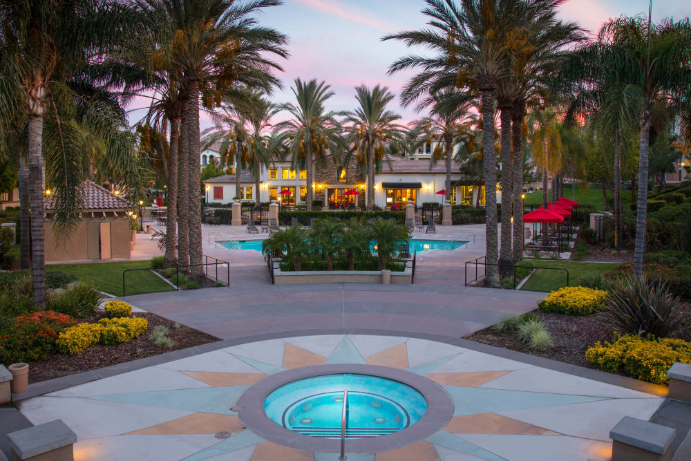Resort-style swimming pool with a spa at Esplanade Apartment Homes in Riverside, California