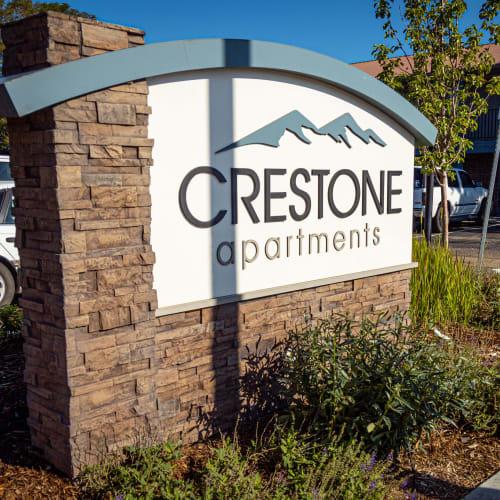 Front sign at Crestone Apartments in Brighton, Colorado