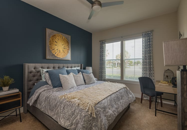 Lovely model bedroom at BluWater Apartments in Jacksonville Beach, Florida