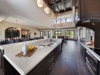 Gourmet kitchen with an island and granite countertops in the clubhouse kitchen at Doral Station in Miami, Florida