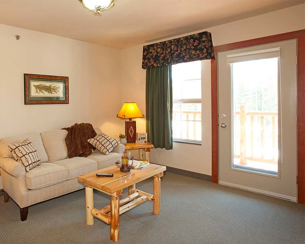 Resident apartment with large windows at Milestone Senior Living Eagle River in Eagle River, Wisconsin.