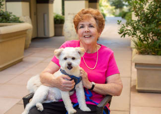 Resident and dog at senior living in Gilbert