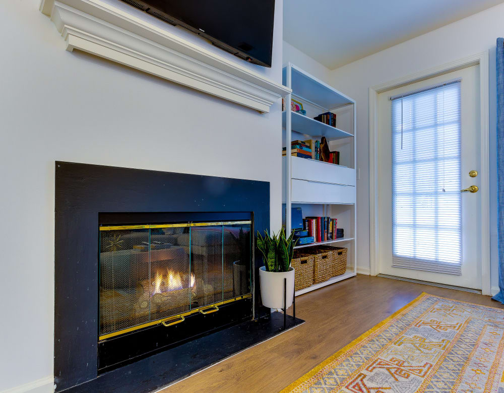 Living room with a fireplace at Eagle Rock Apartments at Freehold in Freehold, New Jersey