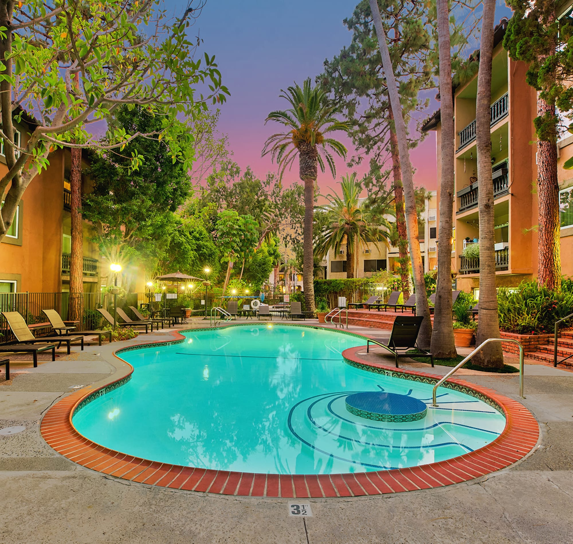 Resort-style swimming pool in the early evening at Casa Granada in Los Angeles, California
