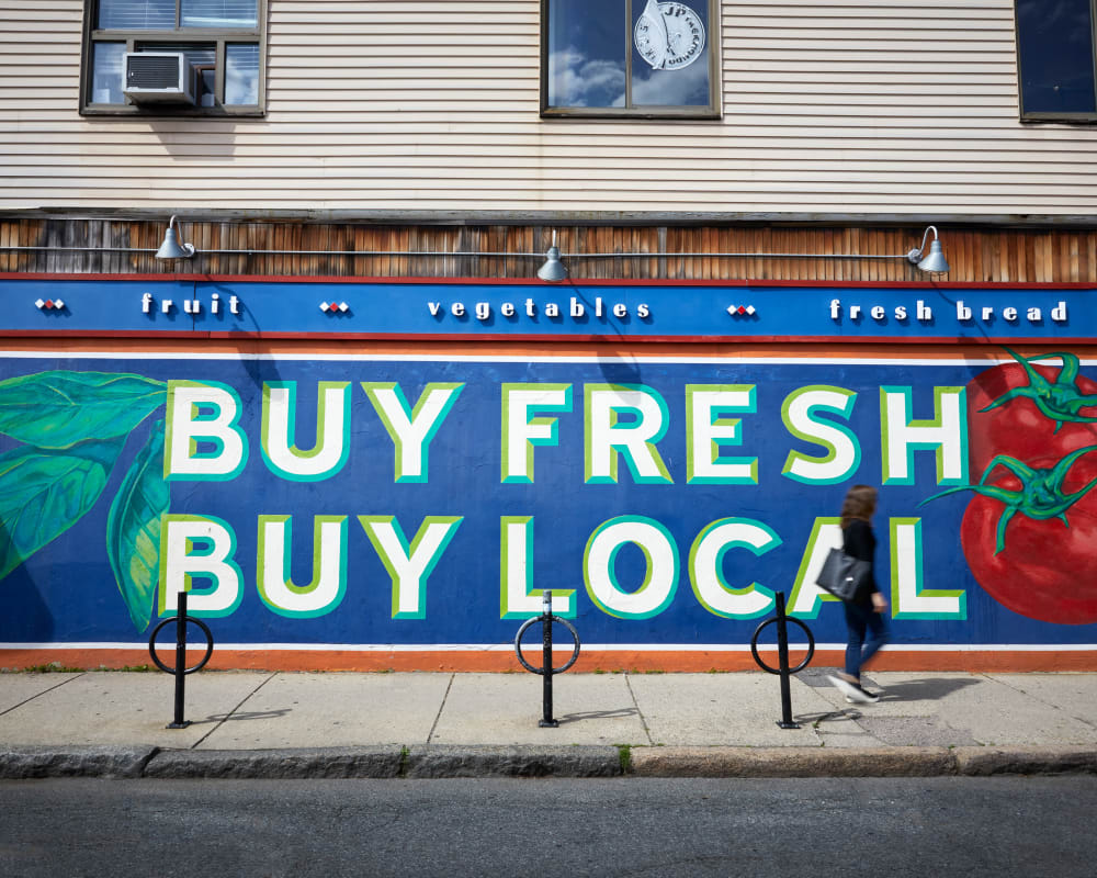 Produce sign outside Velō in Boston, Massachusetts