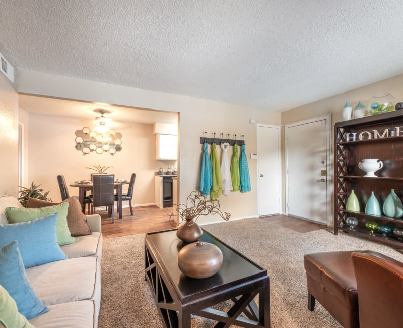 Comfortably decorated living area in a model home at 8500 Harwood Apartment Homes in North Richland Hills, Texas