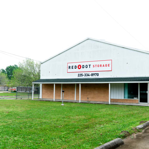 Exterior view of office building at Red Dot Storage in Baker, Louisiana with outdoor RV storage in the background