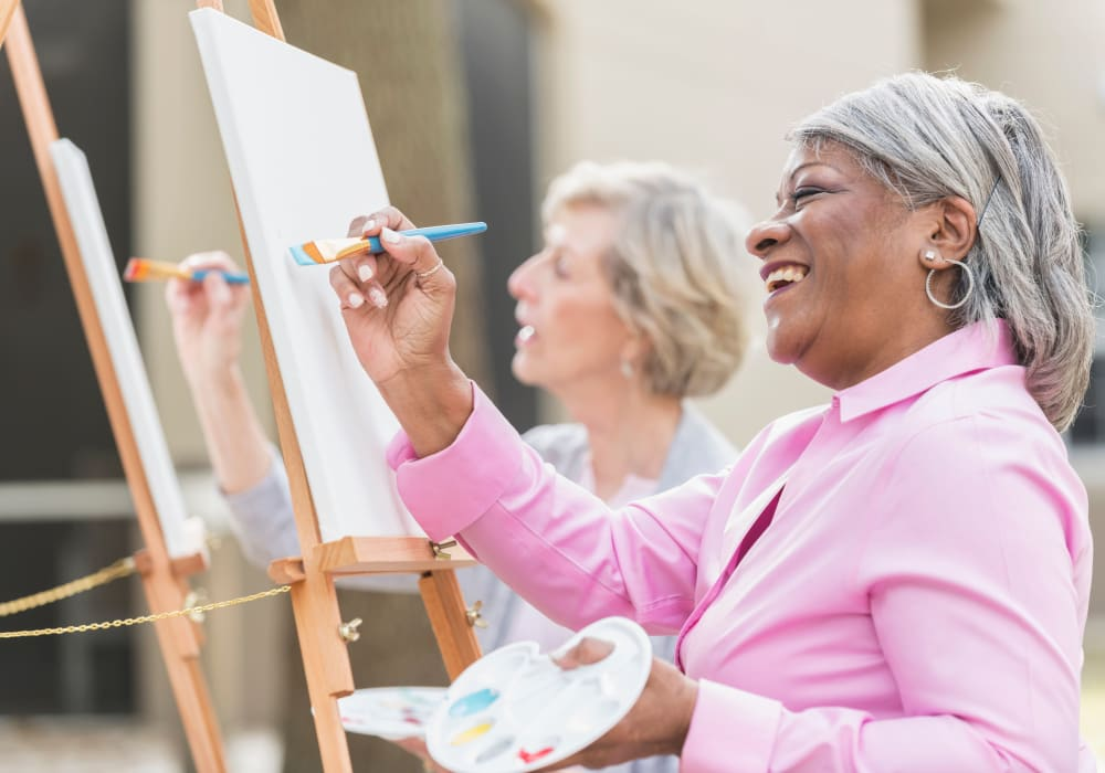 Residents painting together at Holden of Bellevue in Bellevue, Washington.