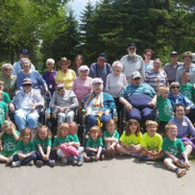 Residents and kids at a picnic at Ebenezer Ridges Campus in Burnsville, Minnesota