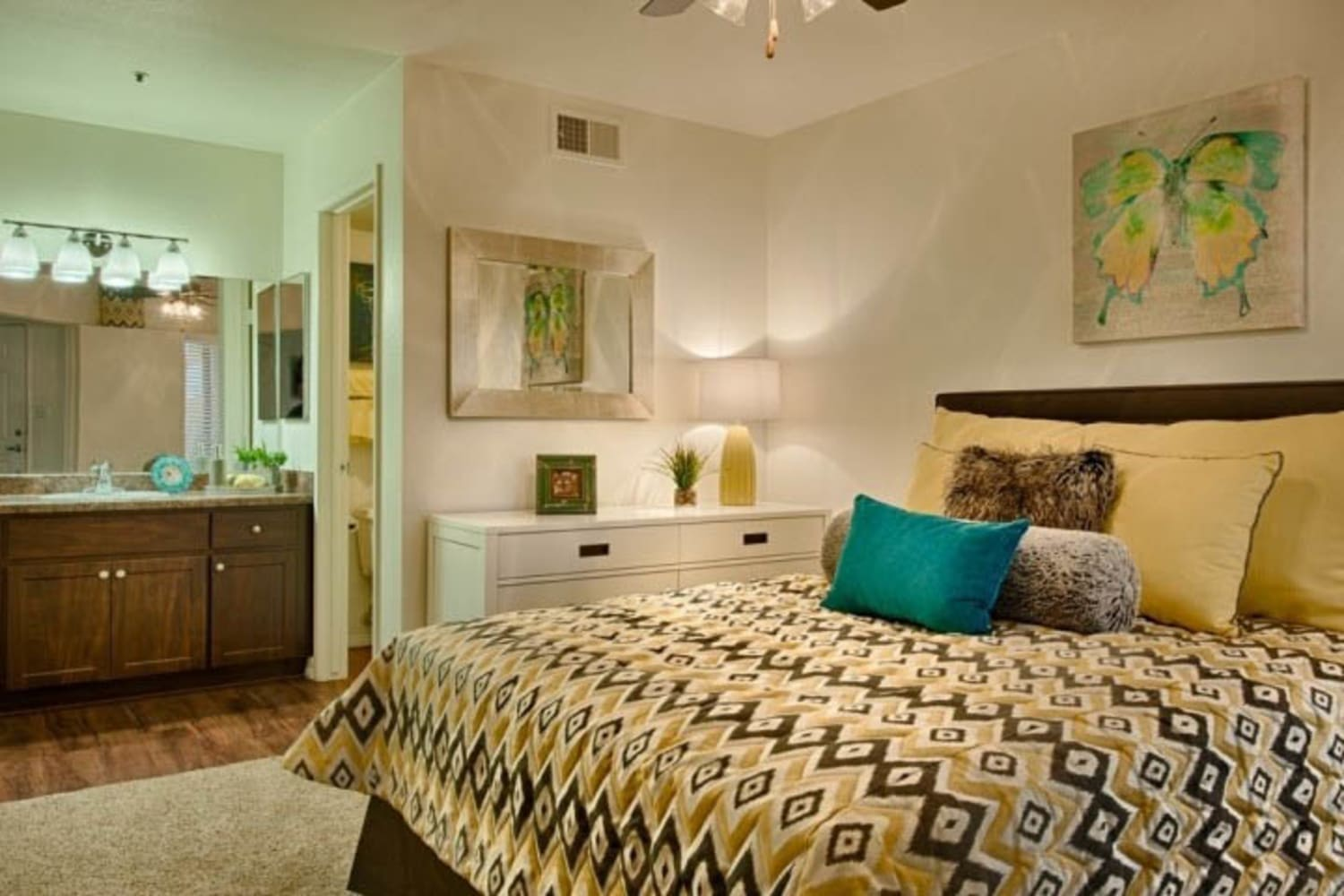 Master bedroom with bathroom at Cabrillo Apartments in Scottsdale, Arizona