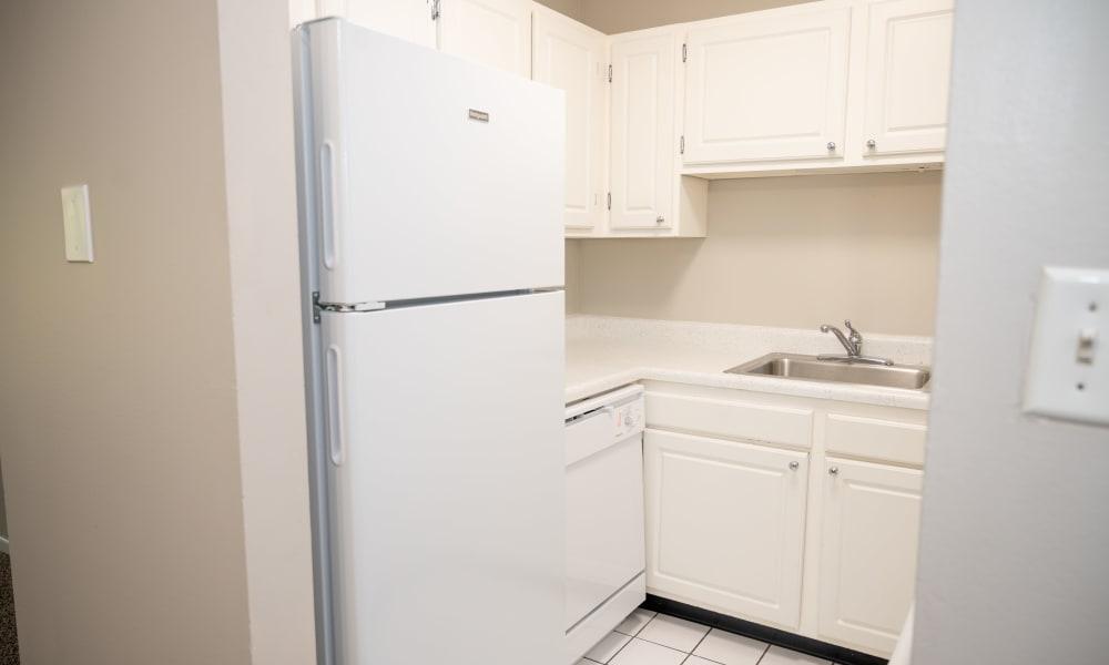 Sleek kitchen with white appliances at Mandalane Apartments in Wheeling, Illinois