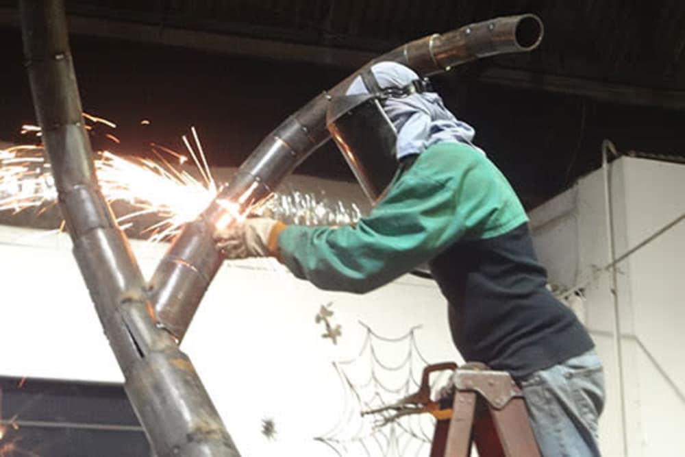 Welding an art display for Jefferson Westshore in Tampa, Florida