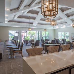 Room filled with tables and chairs at Sunstone Village in Denton, Texas