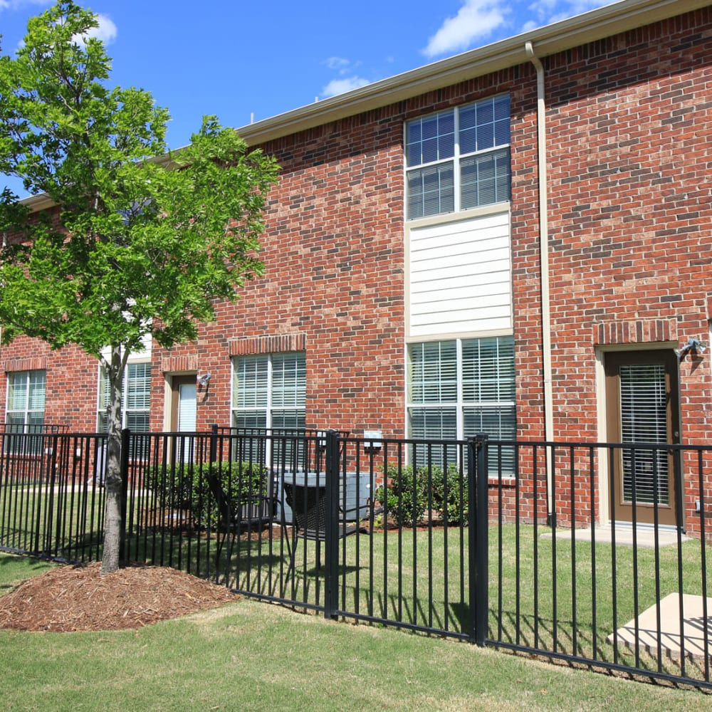 Gated yards outside townhomes at Oaks Estates of Coppell in Coppell, Texas