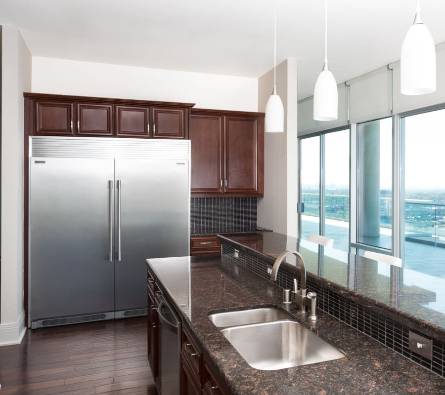 Kitchen with beautiful large windows at The Heights at Park Lane