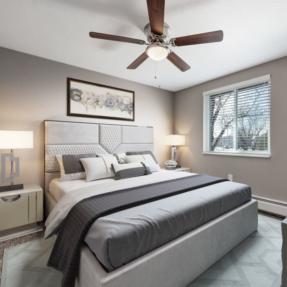 Bedroom with ceiling fan at Southglenn Place in Centennial, Colorado