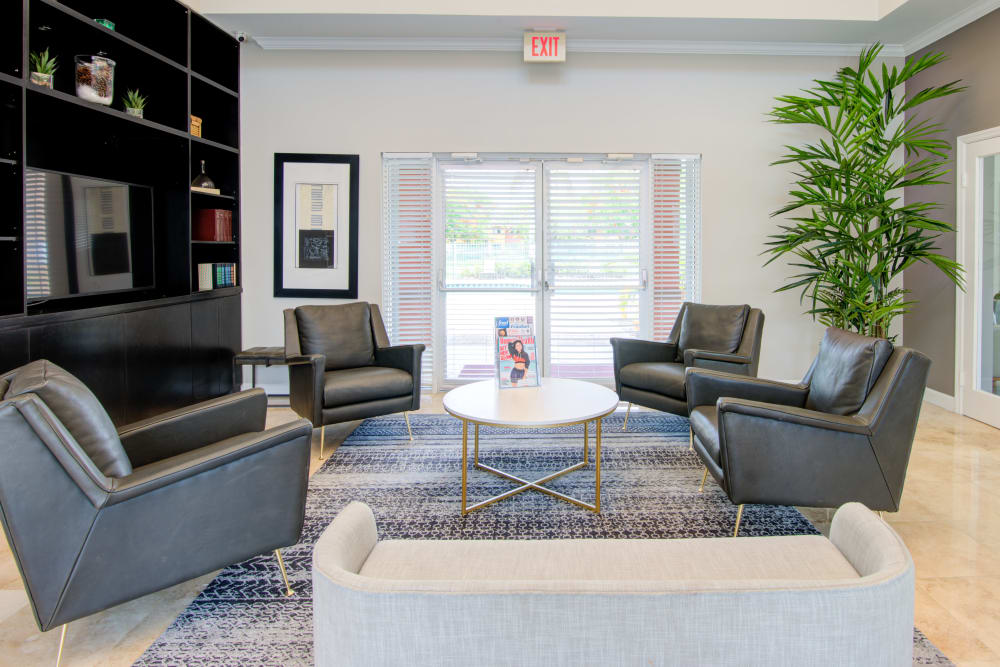 A clubhouse with comfortable seating at Running Brook Apartments in Miami, Florida