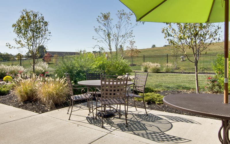 Outdoor patio with chairs at Sugar Creek Senior Living in Troy, Missouri