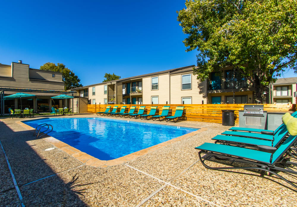 Outdoor pool and seating at Sausalito Apartments in College Station, Texas