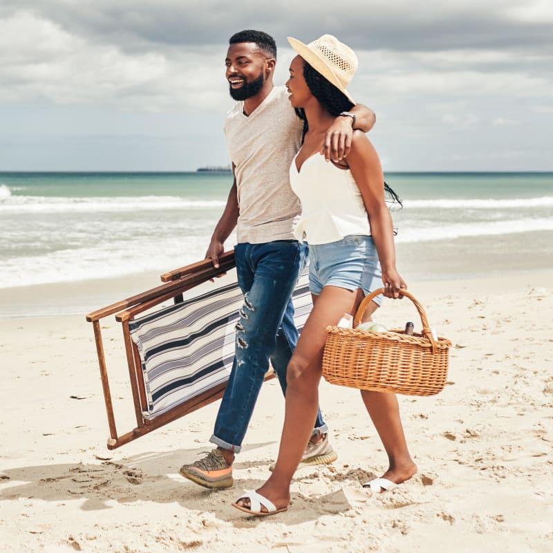 Couple walking along the beach looking for a picnic spot near Portside Ventura Harbor in Ventura, California
