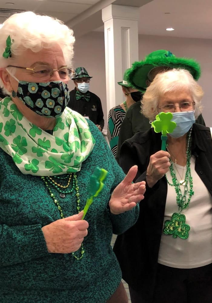 two senior women celebrating