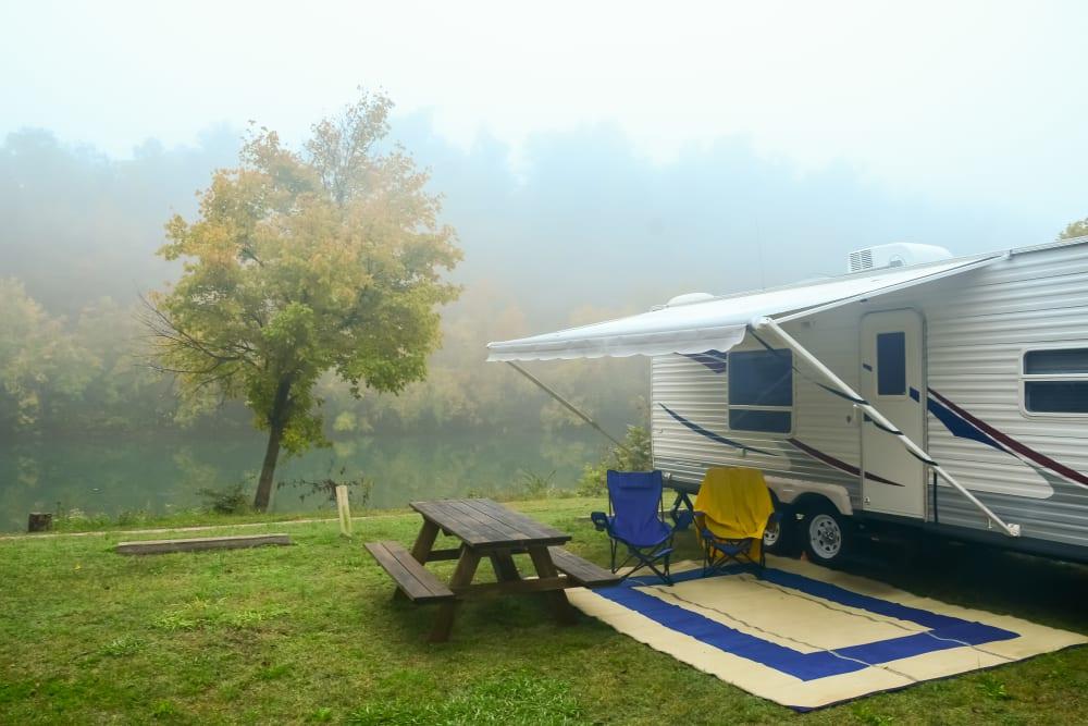 An RV campsite on a foggy morning.