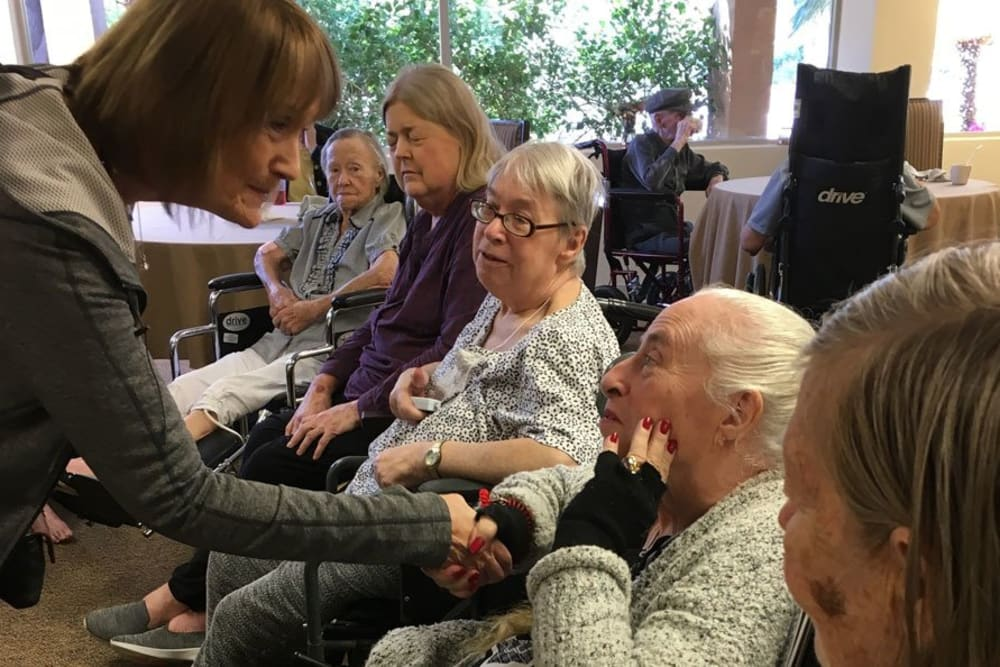 Residents socializing at Woodland Palms Memory Care in Tucson, AZ