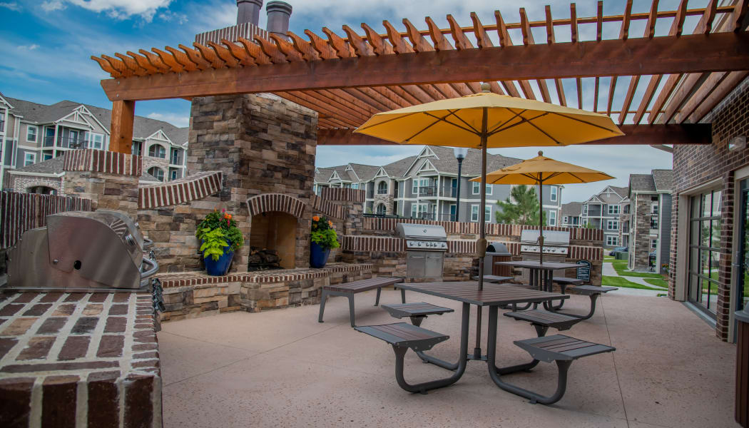 Outdoor grill and lounge area at Cottages at Crestview in Wichita, Kansas