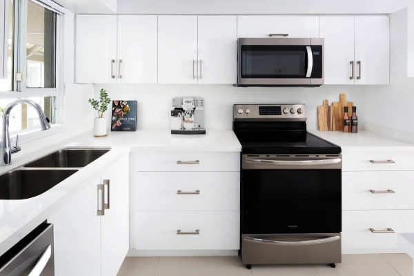 Modern kitchen with white cabinetry at Larchway Gardens in Vancouver, British Columbia