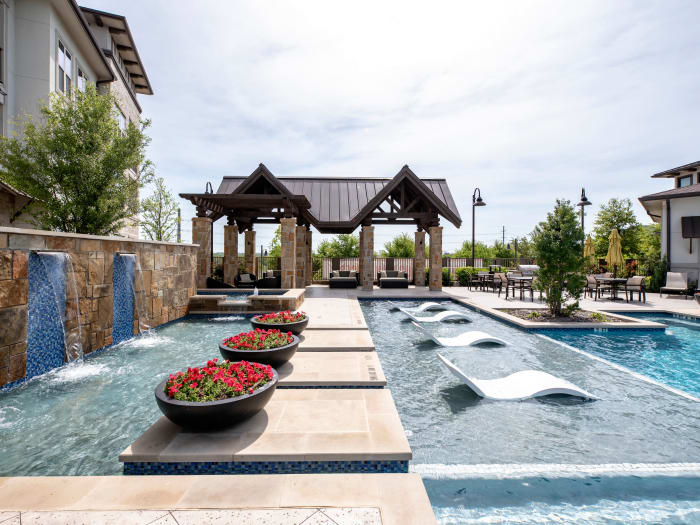 Gorgeous swimming pool area at Domain at Midtown Park in Dallas