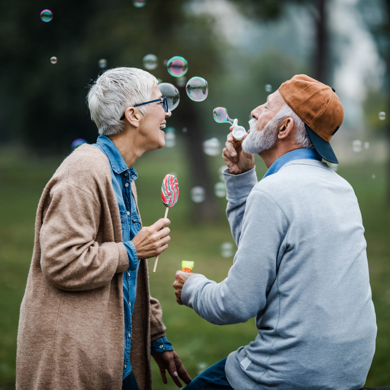 Couple blowing bubbles at Farmington Square Tualatin in Tualatin, Oregon