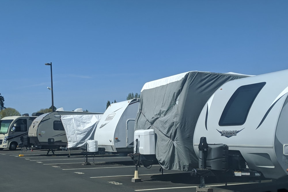 A covered RV at Canby RV & Boat Storage in Canby, Oregon