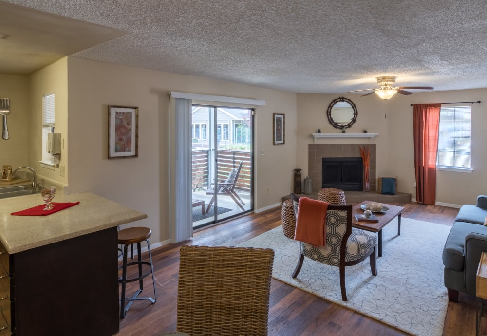 Kitchen and living room with a fireplace at Presidio Apartments in Allen, Texas