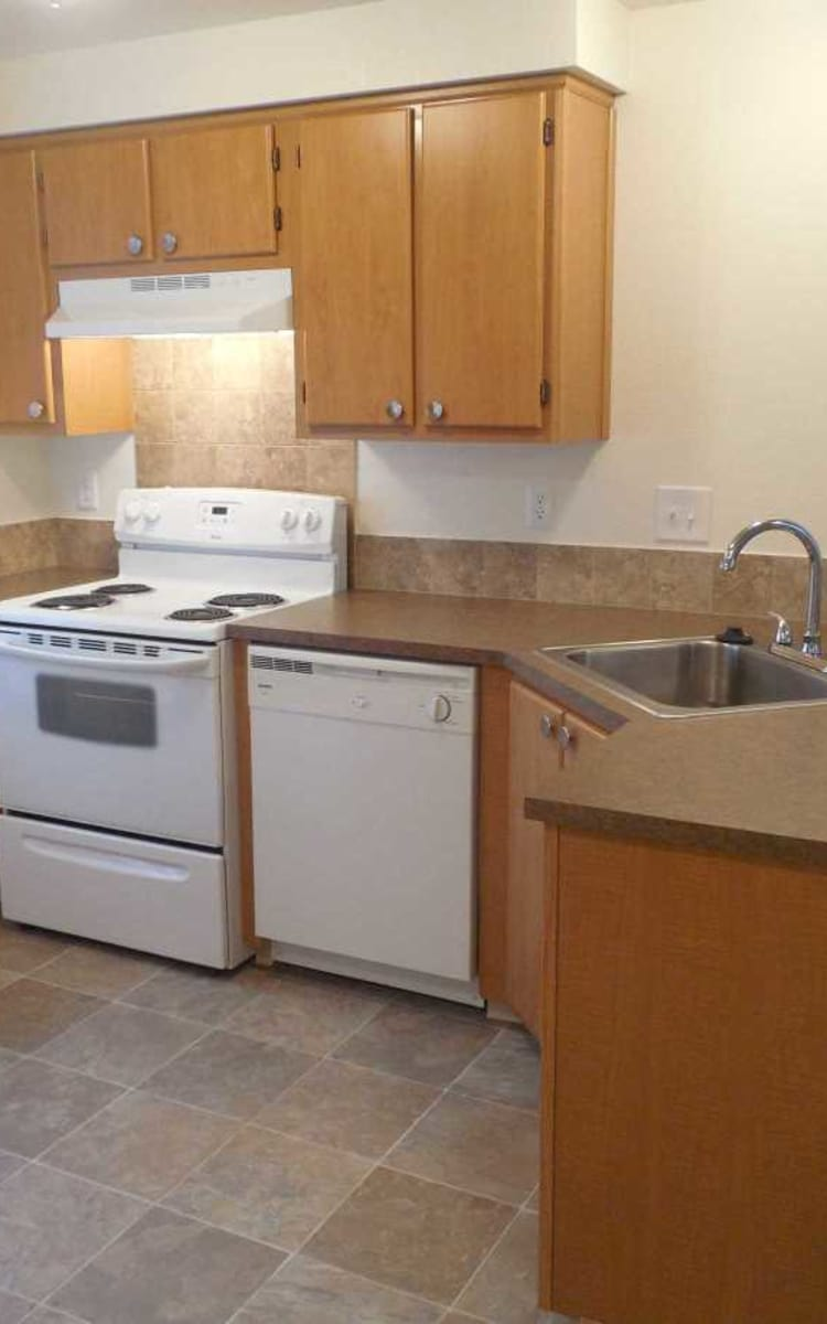 Well equipped kitchen at Conifer Place Apartments in Corvallis, OR