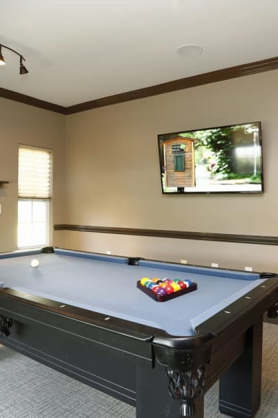 Billiard table with pool sticks at Waterford Place in Greenville, North Carolina