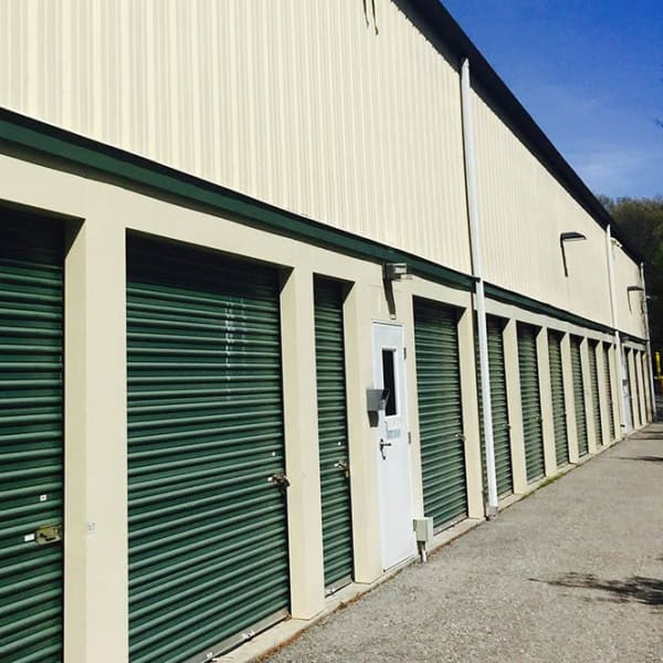 Outdoor storage units with green doors at StorQuest Express - Self Service Storage in Briarcliff Manor, New York