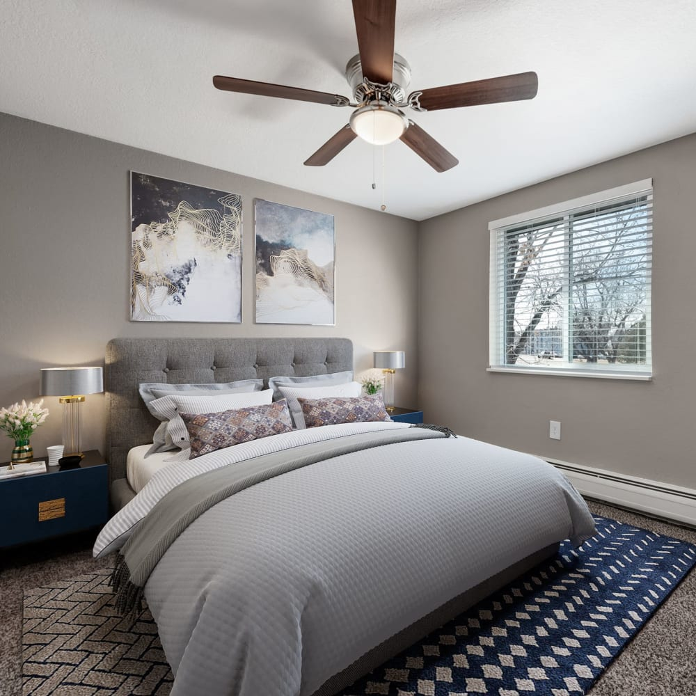 Bedroom with large window at Southglenn Place in Centennial, Colorado